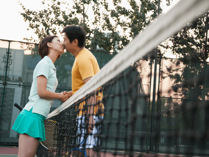 date idea- couple kissing during tennis