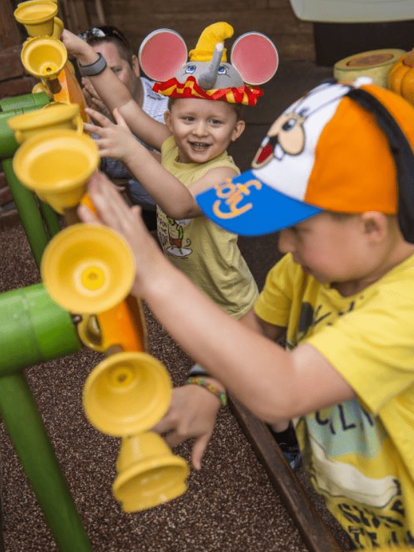children at the interactive queue at the Pooh Ride