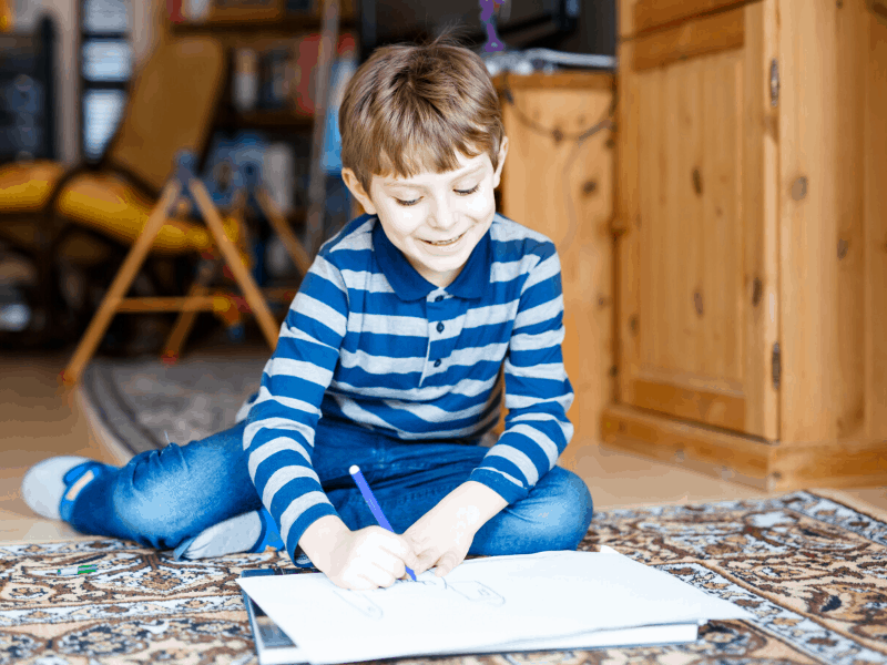 boy at home writing a story