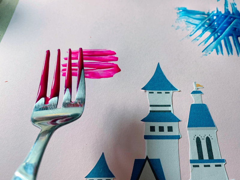 picture of fork with pink paint about to paint firework