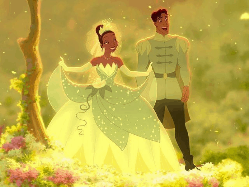 Princess Tiana in her green gown with Prince Naveen