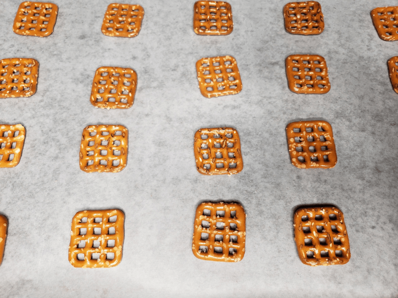 pretzel squares on parchment lined cookie sheet