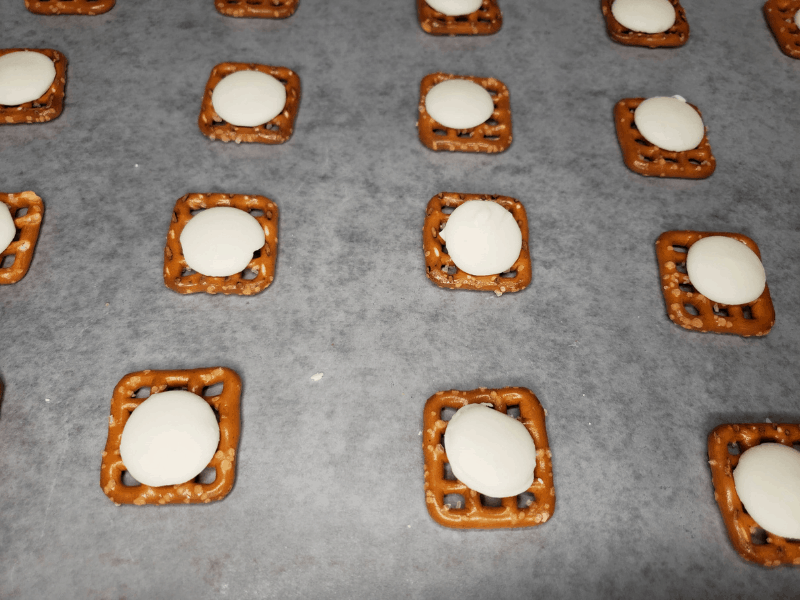 white chocolate melting pieces added to the top of the pretzels