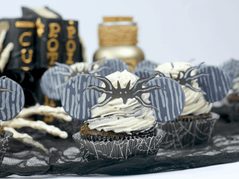 Nightmare Before Christmas Jack Cupcakes with a blurred potion books in background