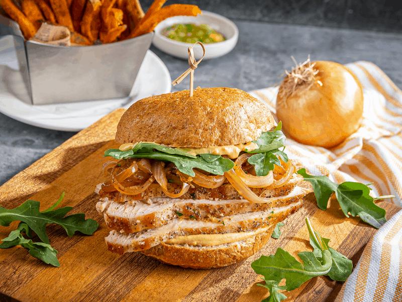 french onion turkey bistro sandwich sandwich on a cutting board