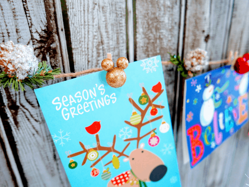 Mickey Mouse Christmas Card Garland holding cards