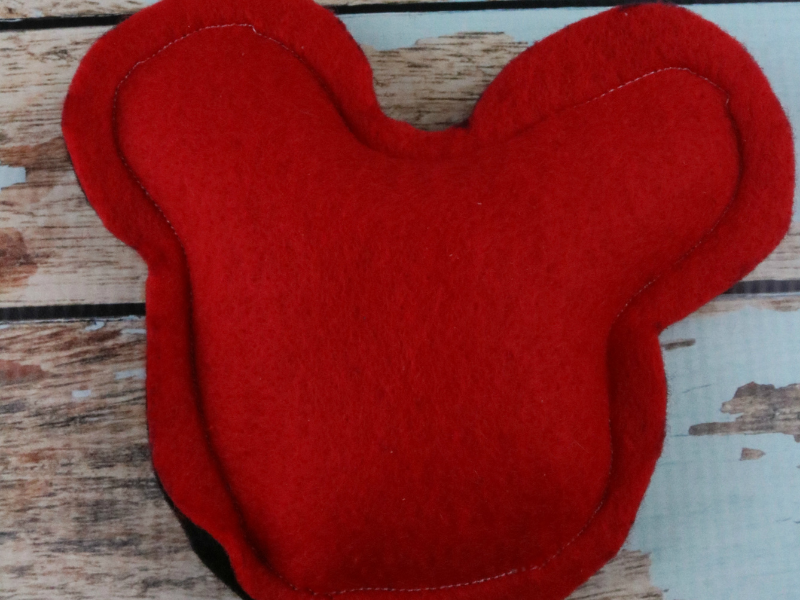 Mickey head ice pack red side on wood/blue background