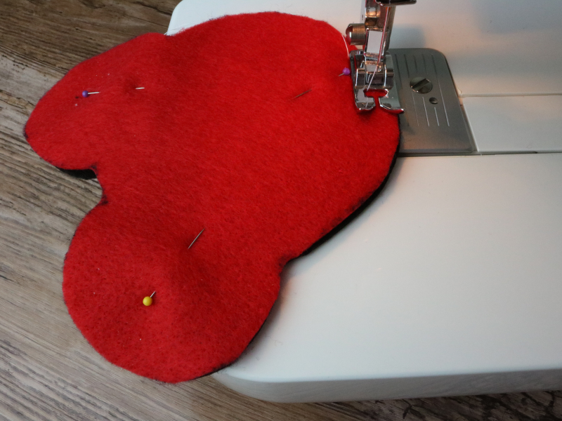 pinned mickey heads felt pieces being sewn together with sewing machine
