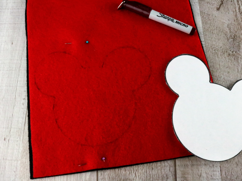 cut pot Mickey head pattern traced out on red felt.