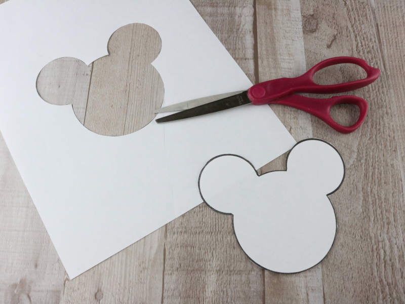 DIY Mickey Mouse Cold Pack pattern and scissors on wood background