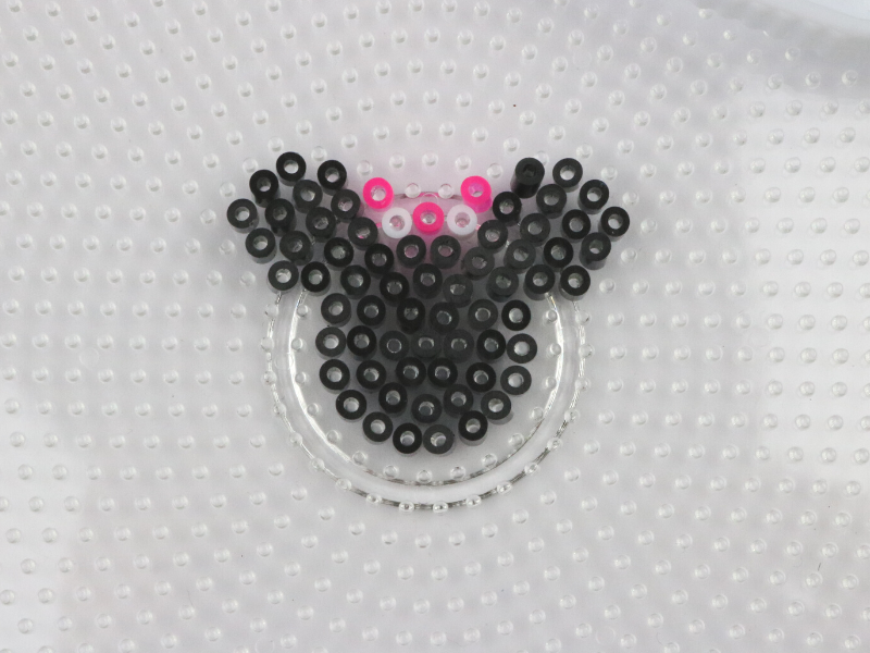 fuse beads laid out in Minnie Mouse design