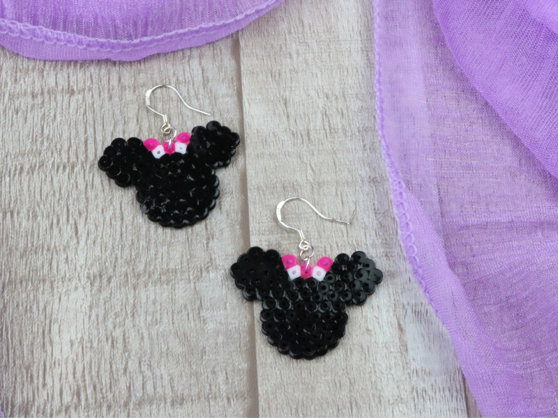 Mini Fuse Bead Minnie Mouse Earrings on wood surface with purple scarf