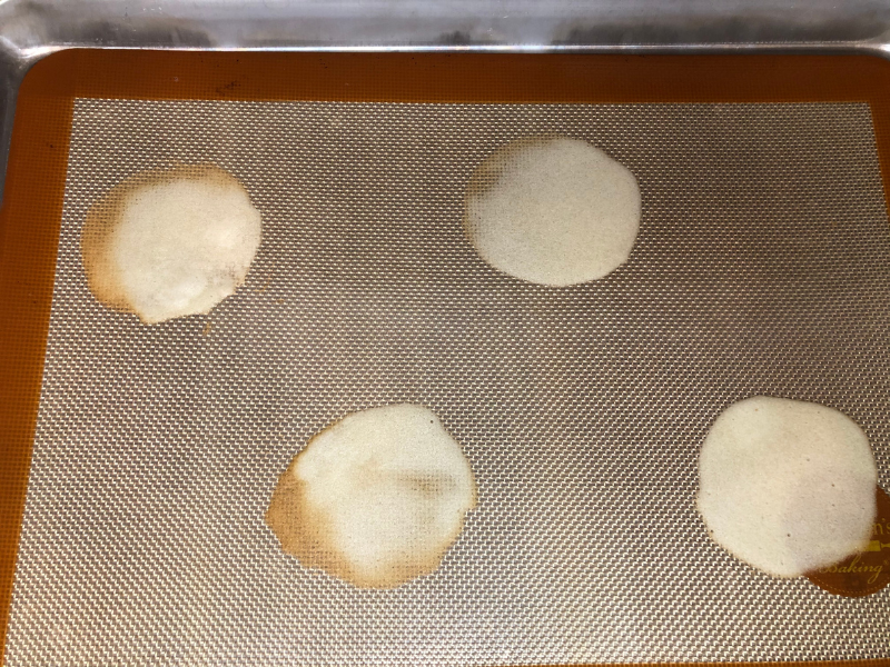 baked cookies with golden brown edges on cookie sheet