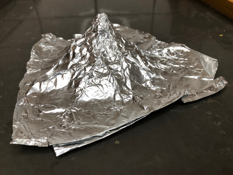 foil shaped into a cone for Raya's hat