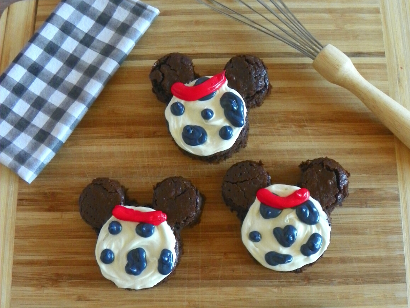 101 Dalmatians Inspired Brownies on wood chopping board with black white checkered towel and whisk on side
