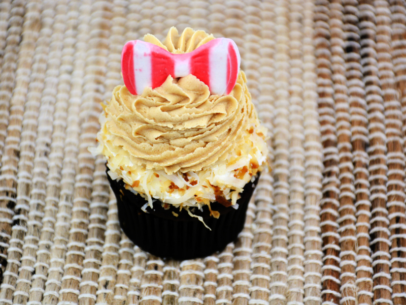 striped bow on top of peanut butter frosting