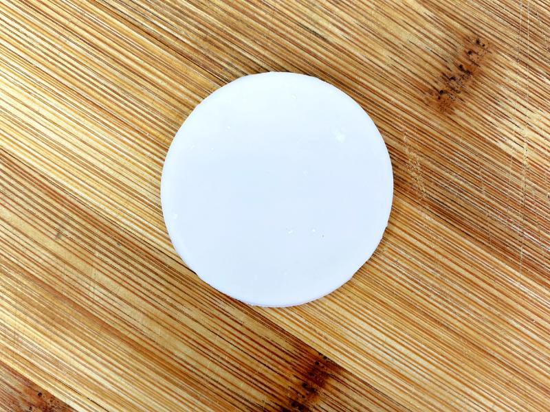 white fondant circle on cutting board