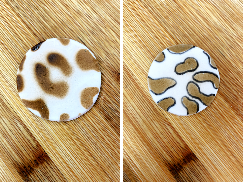 white circle fondant with brown leopard spots on one side and the spots have a black outline on the ride side