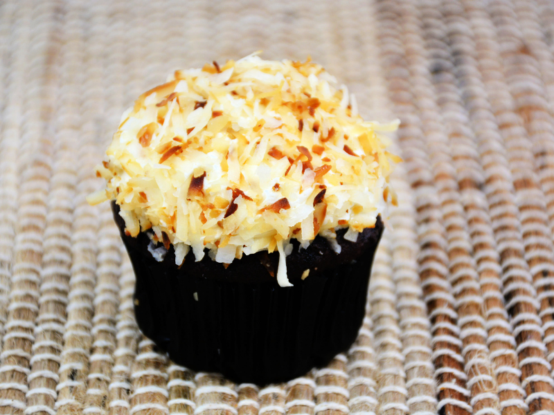 cupcake frosted with toasted coconut on it