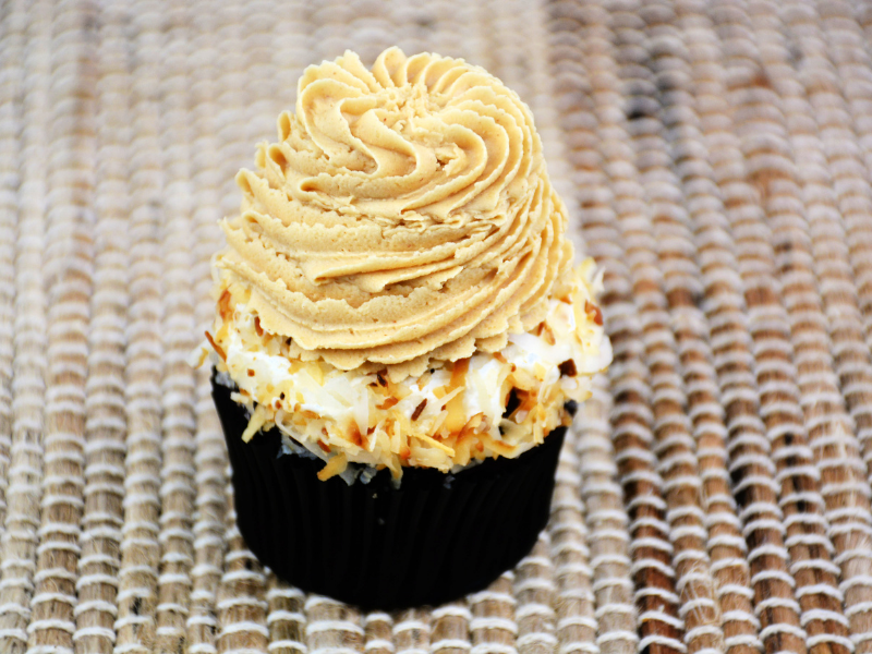 toasted coconut frosting piped onto top of coconut frosting